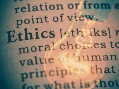 "Lightbulb overlaid on definition of ""ethics"""