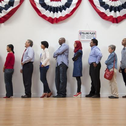 Voters wait in line to cast their ballots.