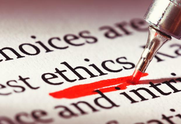 "Red pen underlining the word ""ethics"""